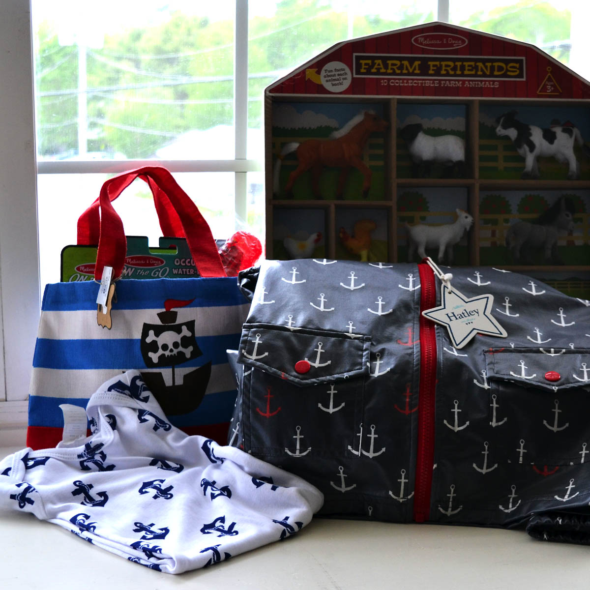 Children's Gift Basket - Generously provided by the Gleason Family, this basket contains an assortment of goodies any toddler is sure to love. From farm animals to age appropriate activity books, a pirate bag and even a stylish nautical rain jacket, this basket is sure to provide lots of enjoyment.
