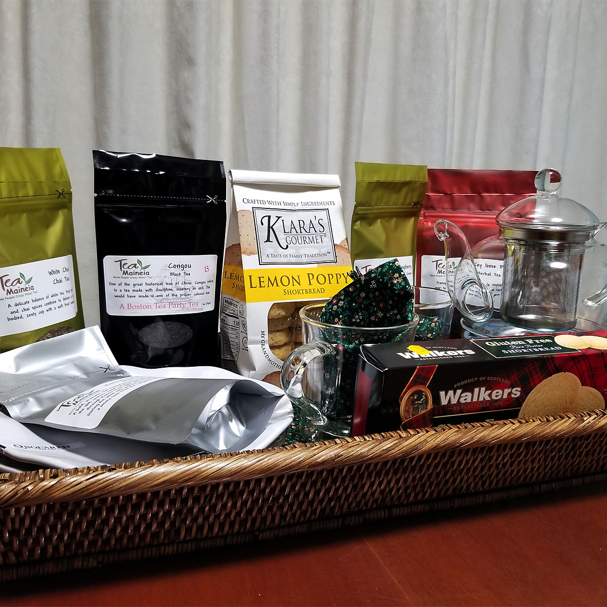 "Tea for Two - The song ""Two for Tea"" sung by Doris Day asks, ""Oh, can't you see how happy we would be?"" If you're the winning bidder for this tea basket, the answer is a resounding ""yes!"" Featuring a collection of gourmet teas along, sweets, and all you need to prepare and serve (including a beautiful woven tray), this basket generously provided by the Beamer Family will make you want to have tea time all the time!Retail Value: $200.00"