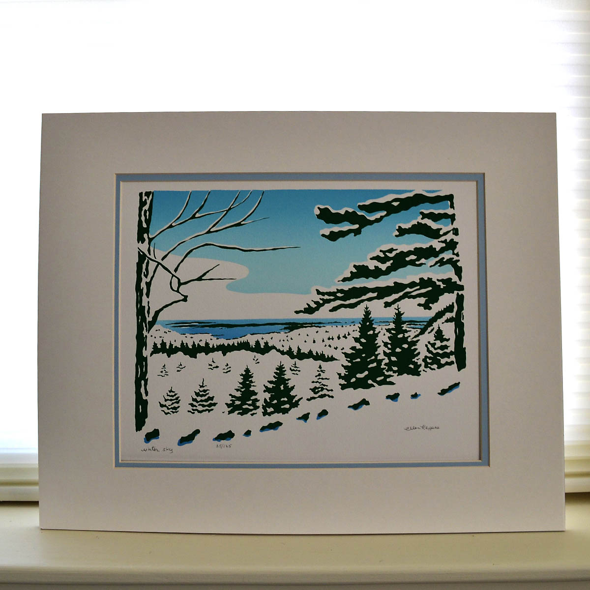 Ellen Kappes Silk-Screen - This matted serigraph is part of a limited edition hand silk-screened by Ellen Kappes. Number 35 of 125, the piece is a playful and cheery depiction of winter on MDI.