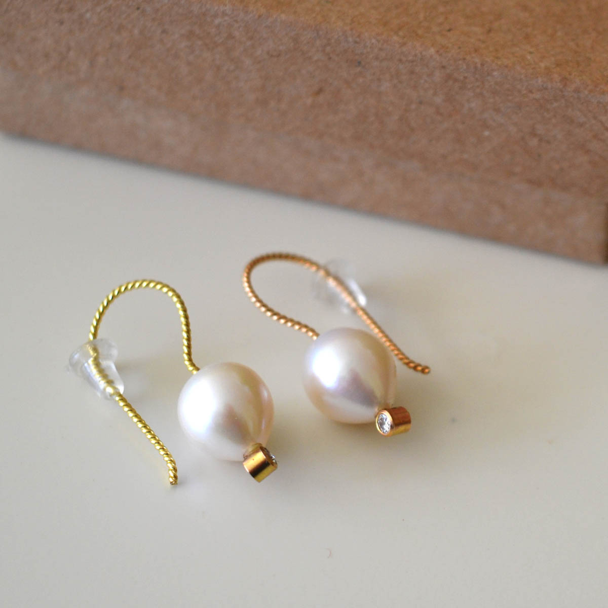Julie Havener Earrings - These earrings created by and generously provided by Julie Havener. Featuring the timeless combination of 14K gold and brilliant pearls, they're sure to always be in style.. You can see more of Julie's work at the Lisa Hall Studio on NE Hbr., or visit her online Etsy shop.Retail Value: $300.00