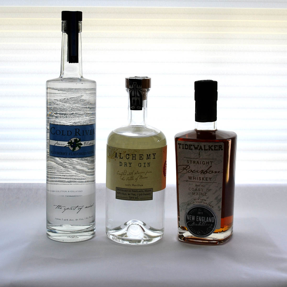 """Taste of Maine Booze Basket - Maine is becoming known for its craft distilleries, and this unique basket features all you need to add a taste of Maine to your bar. Say """"cheers"""" as you raise a glass with either Cold River Blueberry Vodka, Alchemy Dry Gin, or Tidewalker Bourgon Whiskey.Retail Value: $122.00"""