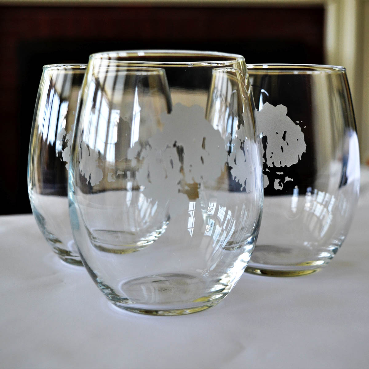 MDI Stemless Wine Glasses - This set of six stemless wine glasses was generously provided by an anonymous donor and purchased right in NEH at the Kimaball Shop. Featuring an etched silhouette of our island home, these glasses are perfect for entertaining.Retail Value: $93.00