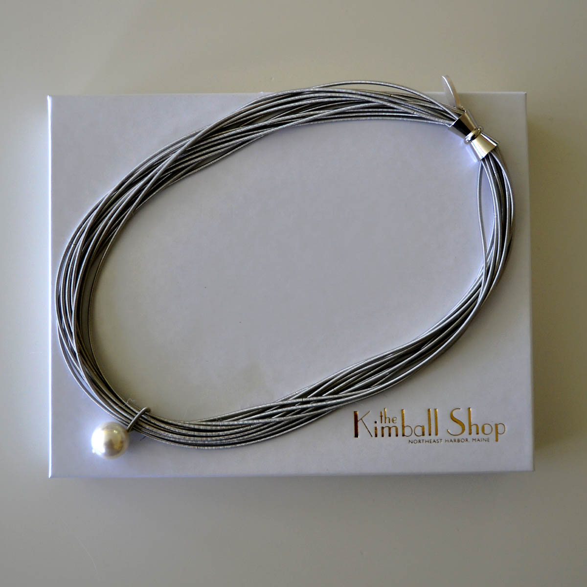 Silver Rope Necklace - Provided by a generous anonymous donor, this silver rope necklace features a single pearl. Informal but elegant, this necklace works with virtually any outfit.Retail Value: $60.00