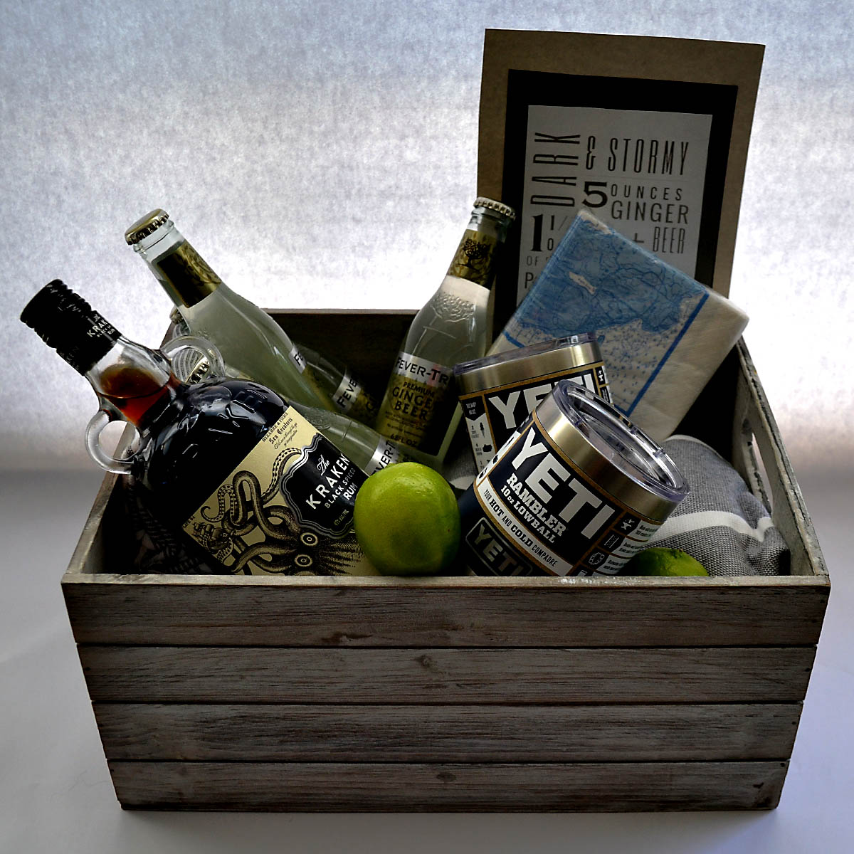 Dark & Stormy Basket - Dark rum, ginger beer, and a little lime— all you need for a Dark & Stormy! This fun basket not only includes all of the makings for the popular drink, it even comes with two Yeti tumblers, cocktail napkins, and a gift certificate to the Islesford Dock Restaurant. Everything you need for the perfect summer evening!