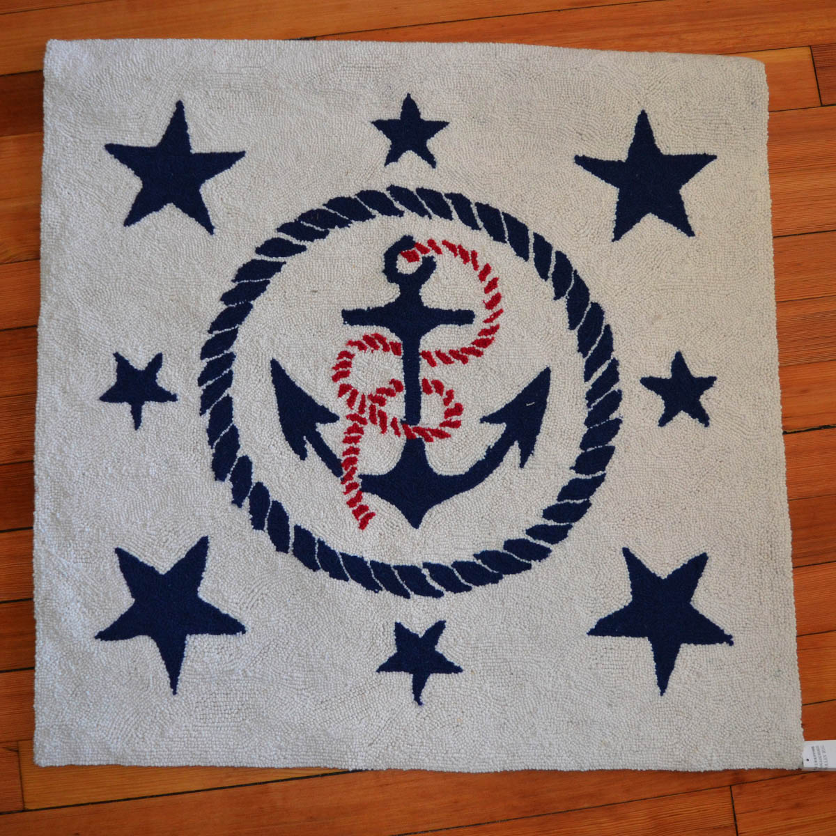 Hooked Nuatical RUG - Our generous neighbors at the Romantic Room have provided this fun and durable 100% wool hooked rug. Featuring a boldly colored nautical theme this small rug is perfect for the porch or entryway to welcome guests all summer long!Retail Value: $135.00