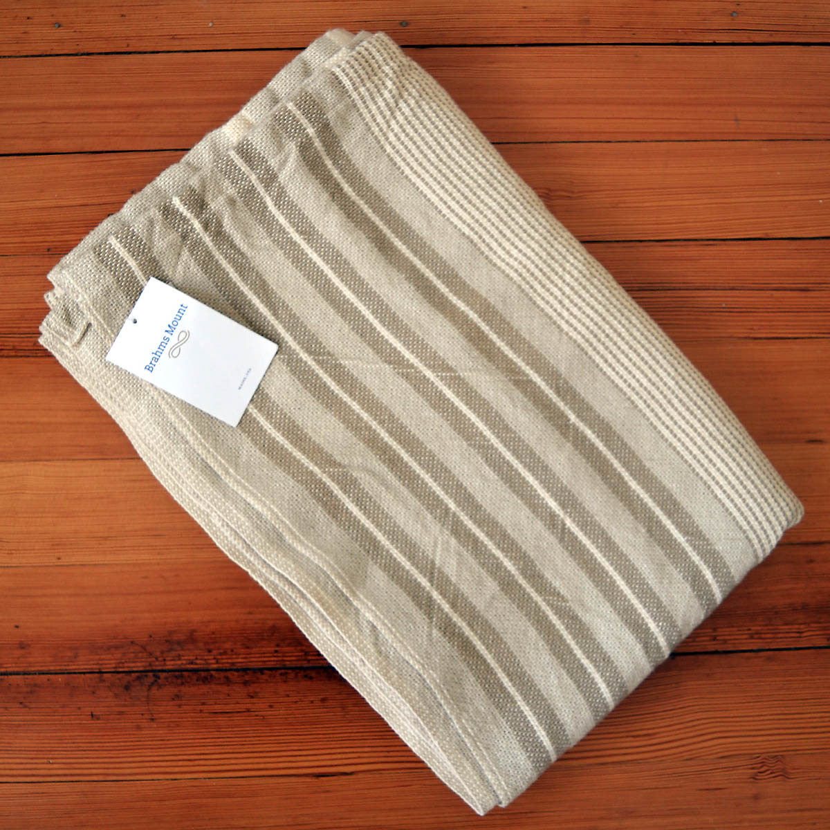 Brahms Mount Blanket - Swallowfield has generously contributed this amazingly well crafted Brhams Mount Blanket. The neutral tone features a varying stripe pattern and is the perfect addition to keep draped over a sofa or chair for those cool evenings. See more of what Swallowfield has to offer at their Main St. shop or online at swallowfieldshop.comRetail Value: $260.00