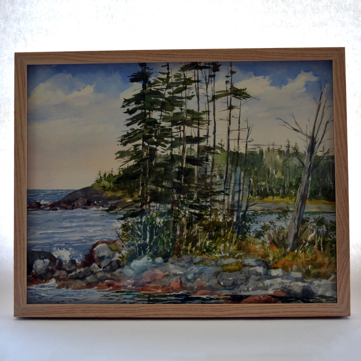 Mark Howard Watercolor - This original watercolor, generously provided by artist Mark Howard, is framed and ready to be displayed. Depicting a rocky coastal seascape, this work would fit perfectly in any area home.Value: $450.00