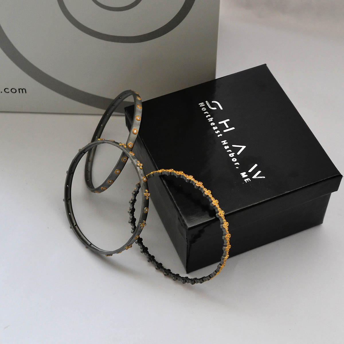 Bangle Bracelets - This fun set of three oxidized bangle bracelets generously provided by Shaw Jewelry feature cubic zirconium embellishments to add a little sparkle. A unique way to add some understated pizzaz to your outfit.Retail Value: $395.00
