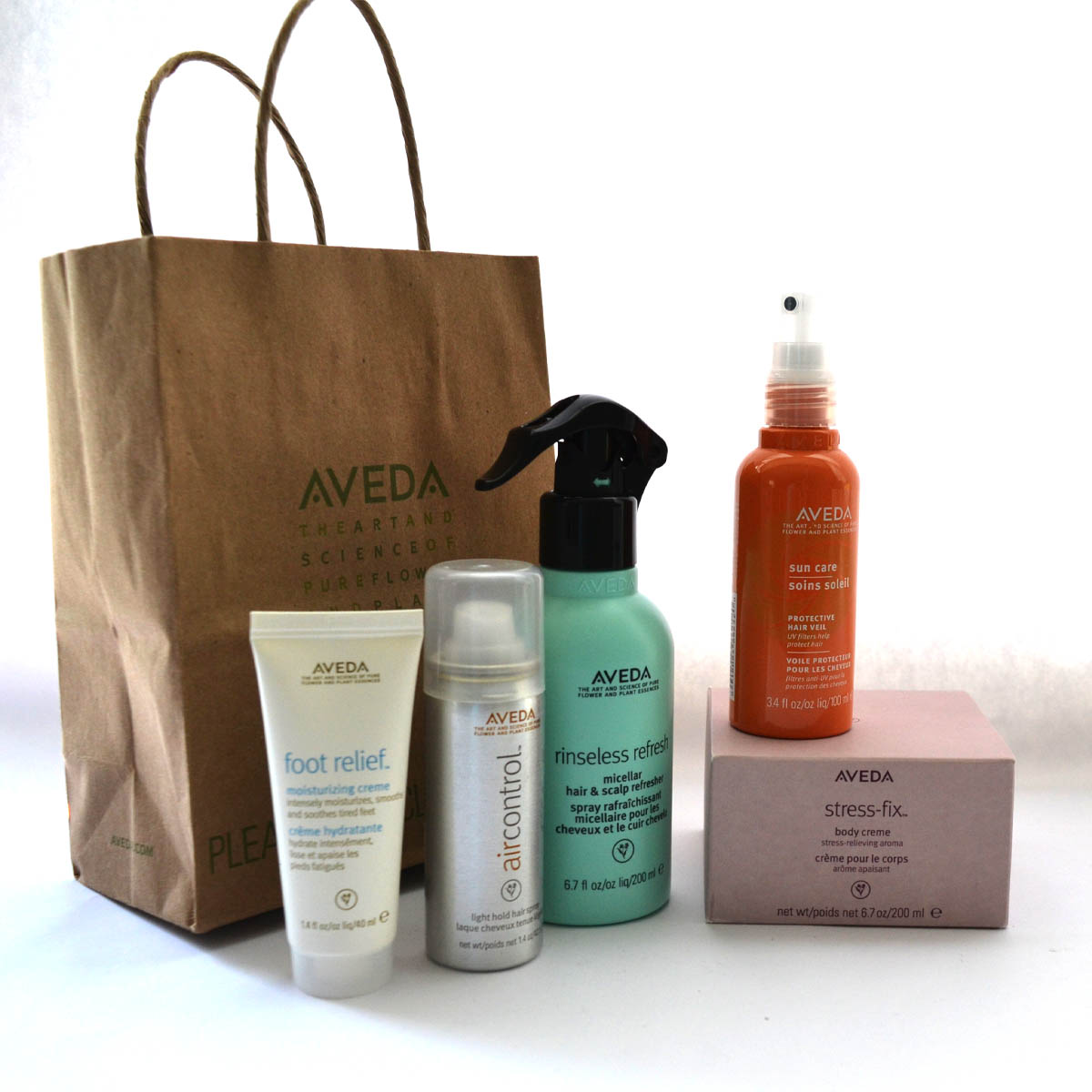 Aveda Hair & Skin Care - Roberto Hostins has generously provided this selection of Aveda beauty products featuring foot relief moisturizing creme, sun care hair veil, air control lightly holding hair spray, rinse less hair refresher, and stress-fix body creme. Be sure to visit Roberto at his NEW second location on Neighborhood Rd. in the WMH Architects building.Retail Value: $140.00