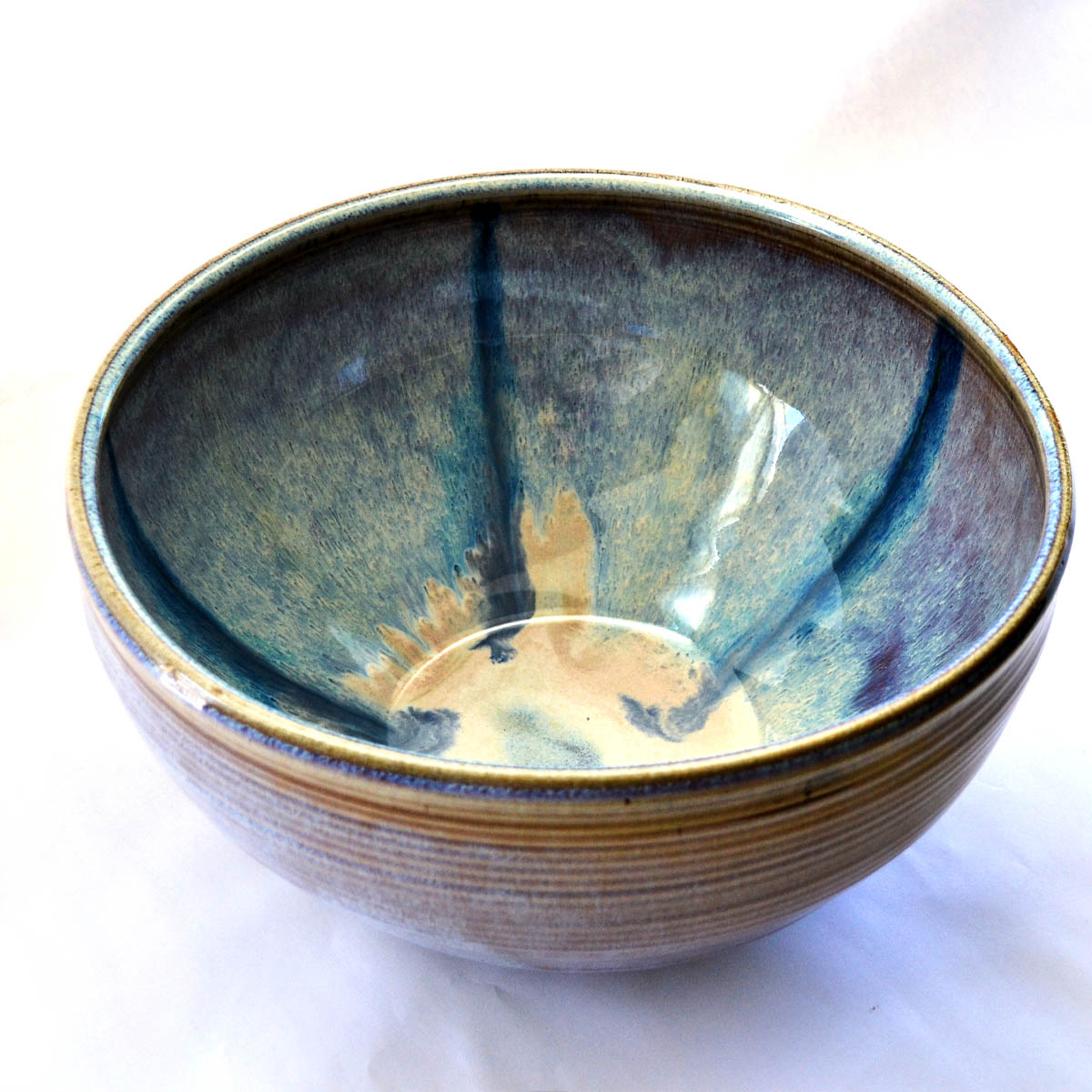 Ceramic Bowl - This oversized hand turned ceramic bowl was generously provided by the Baird Family. It truly is a functional piece of art study enough to have out for everyday use.