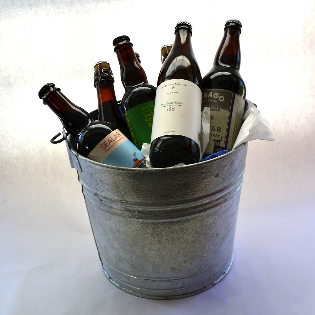 Craft Beer Bucket - The Schmidt Family has generously provided this unique bucket featuring craft brew beers from across Maine. Enjoy beer from some of the nations most award winning breweries, including Sebago, Maine Beer Company, Foulmouth, and more!