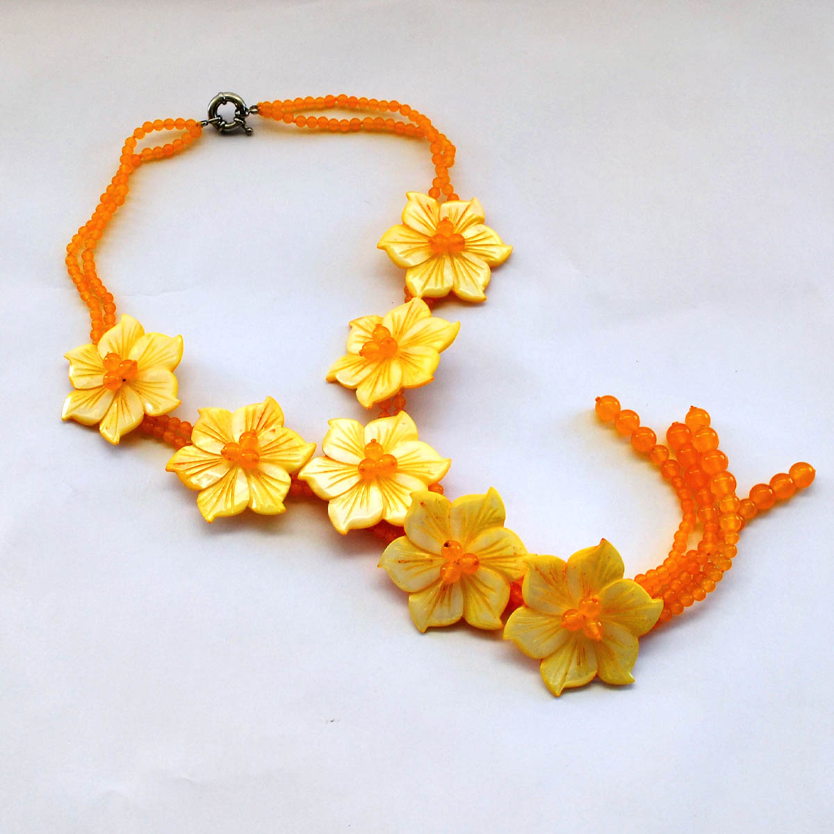 Yellow Jade Necklace - This hand crafted necklace will stand out with its vibrant floral design. Materials include yellow jade along with dyed mother of pearl.