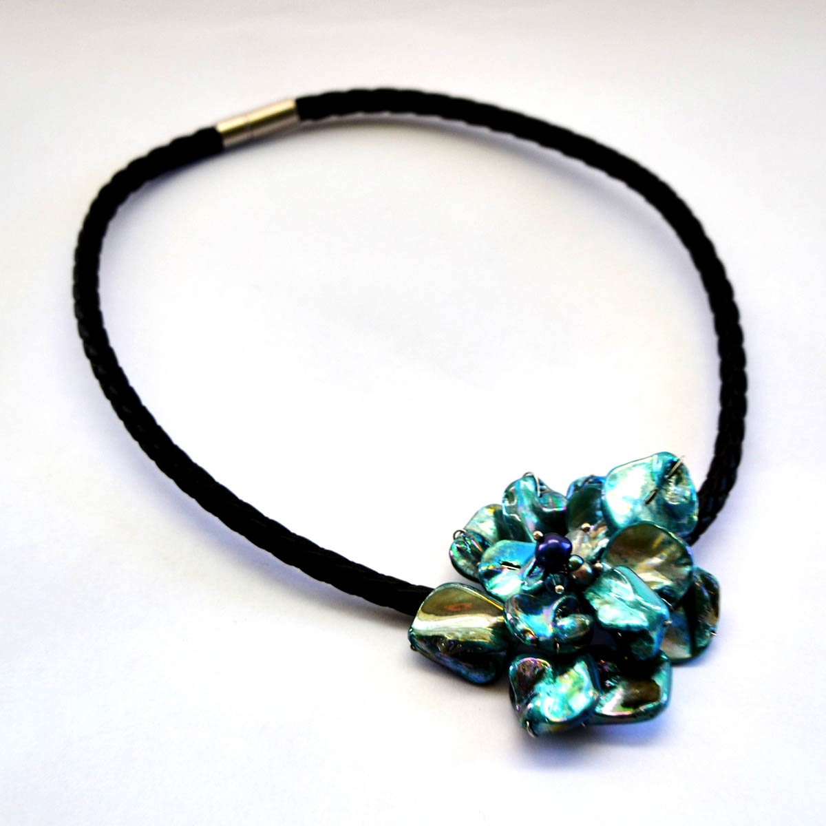 Turquoise Necklace - This stunning necklace features a simple rope band and elegant hand crafted Nepalese turquoise and sterling pendant. Add something fun and unique to your wardrobe!