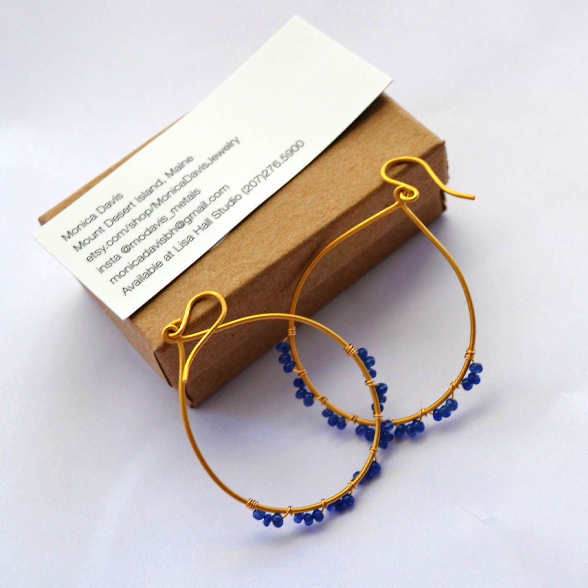 Beaded Earrings - Monica Davis created and generously donated this fun pair of earrings. Featuring vermeil hoops and blue sapphire, these are sure to be noticed and admired.Retail Value: $225.00