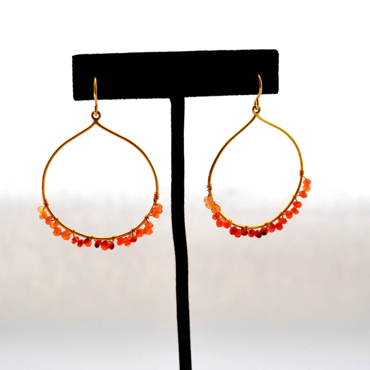 Carnelian Earrings - Monica Davis generously crafted and contributed this beautiful earrings. Featuring vermeil hoops and carnelian stones these would be a stylish way to accessorize any wardrobe!Retail Value: $250.00
