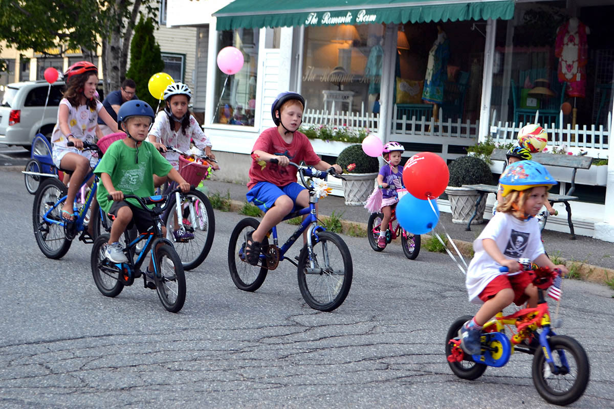 Riders zoom along the parade route for sundaes at the finish line