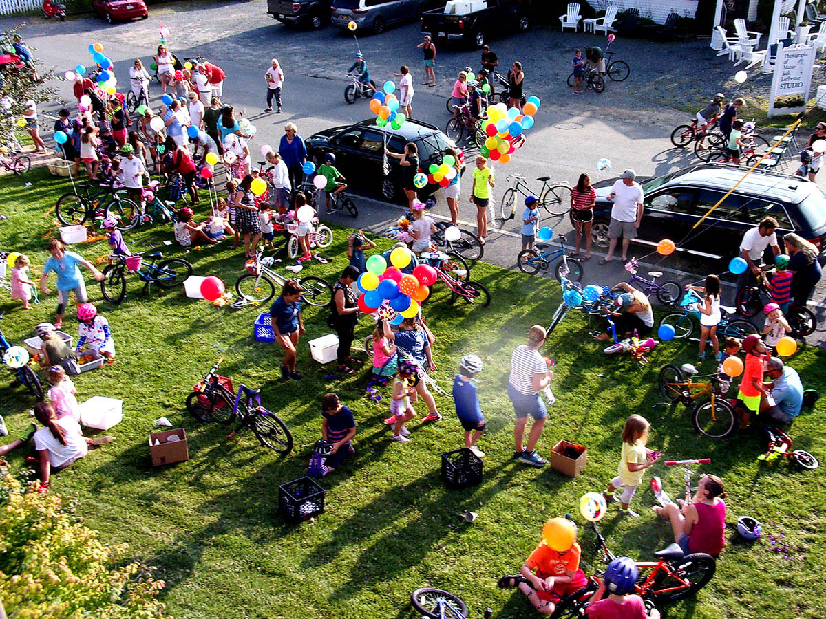 Participants decorate their bikes prior to the 2018 Bike Parade