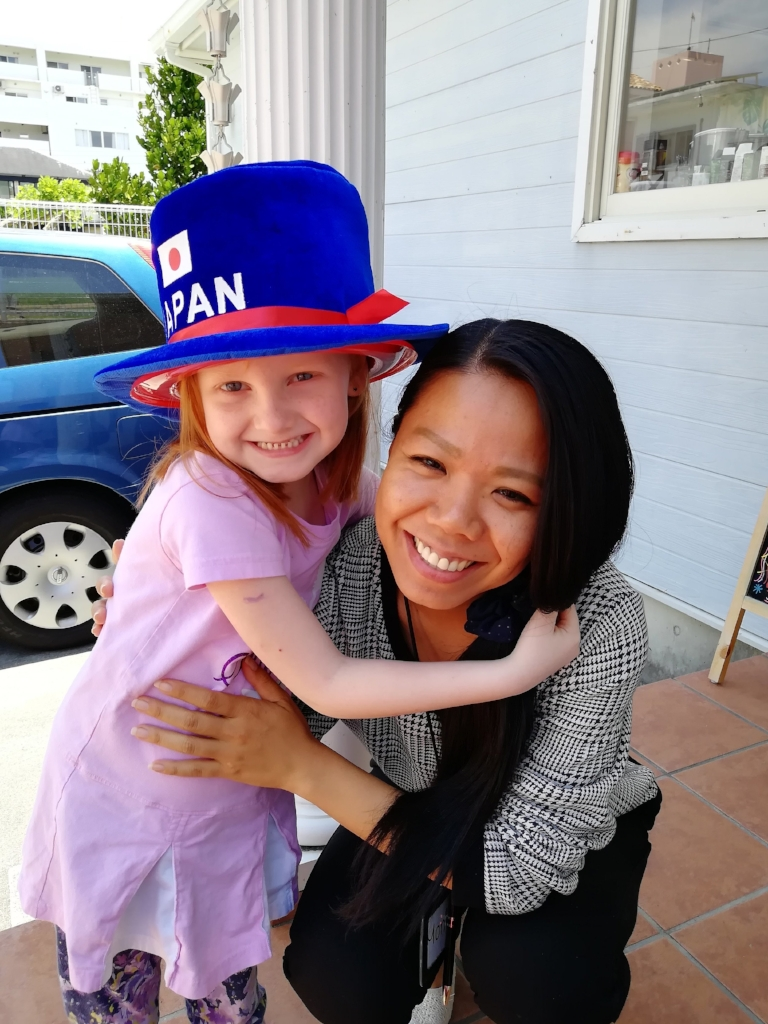 This one was taken with our language teacher -- Phin is a hit wherever she goes. Her light shines so bright!