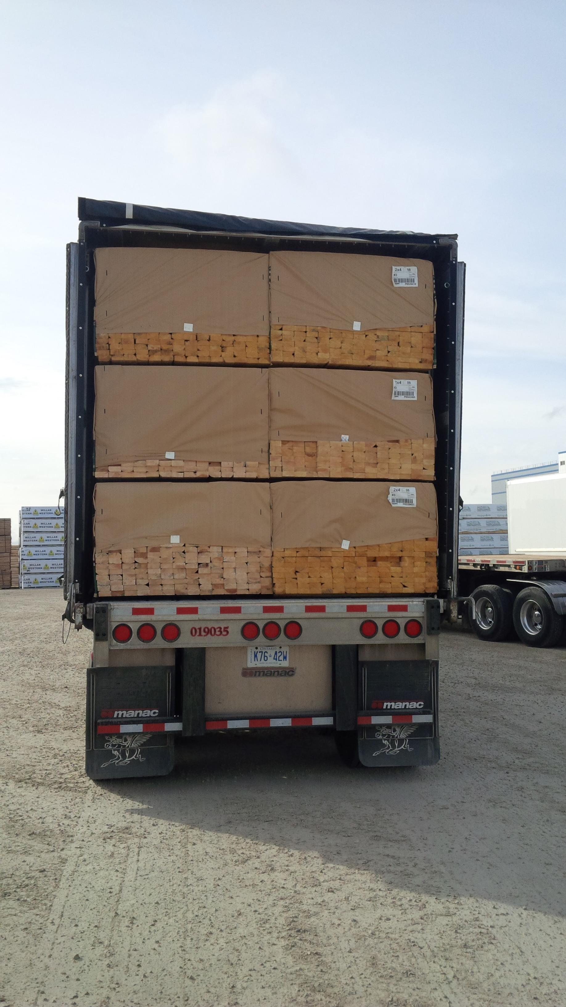 3x2 lumber bundles stacked.
