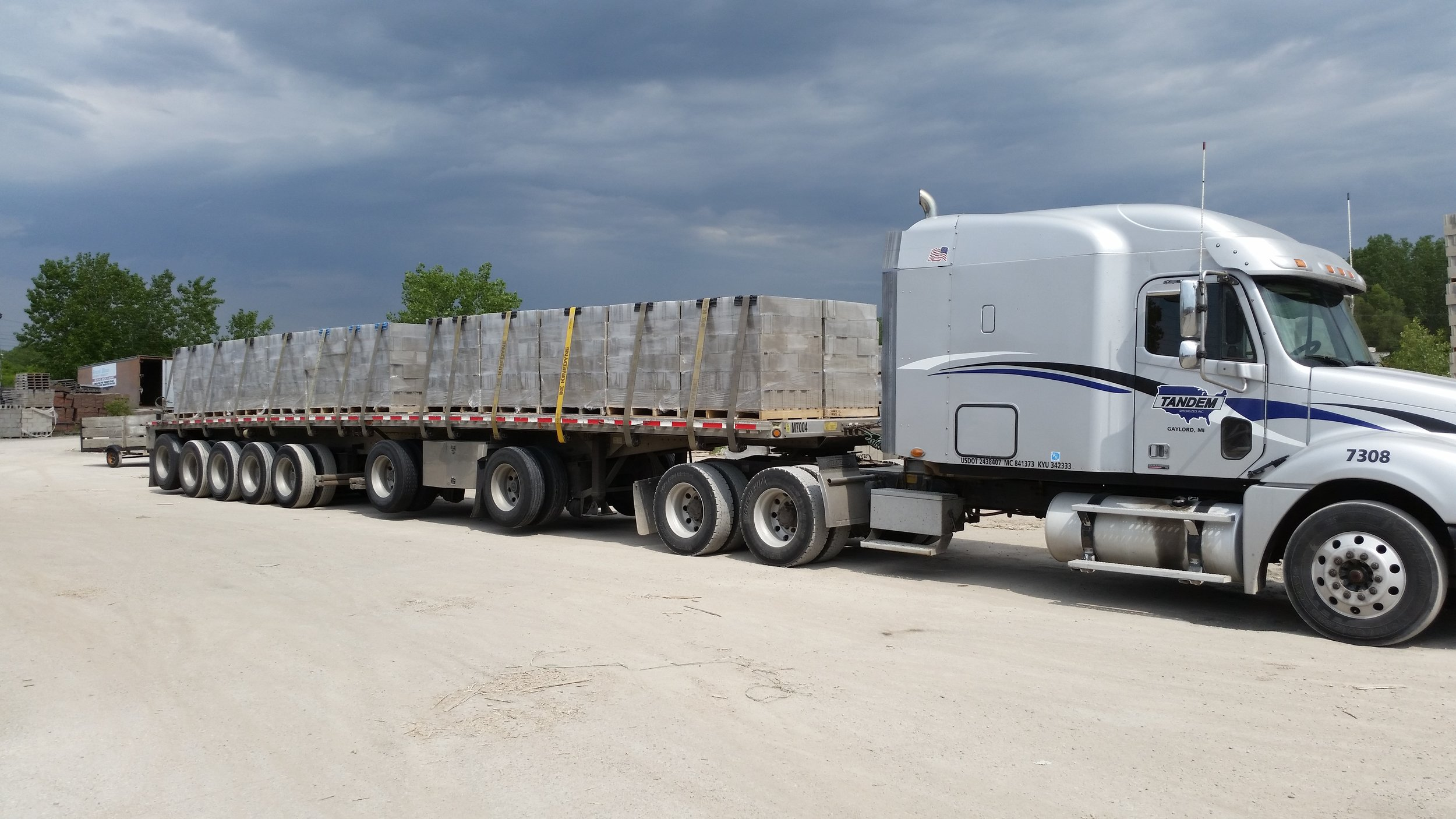 Open multi axle flatbed loaded with heavy block