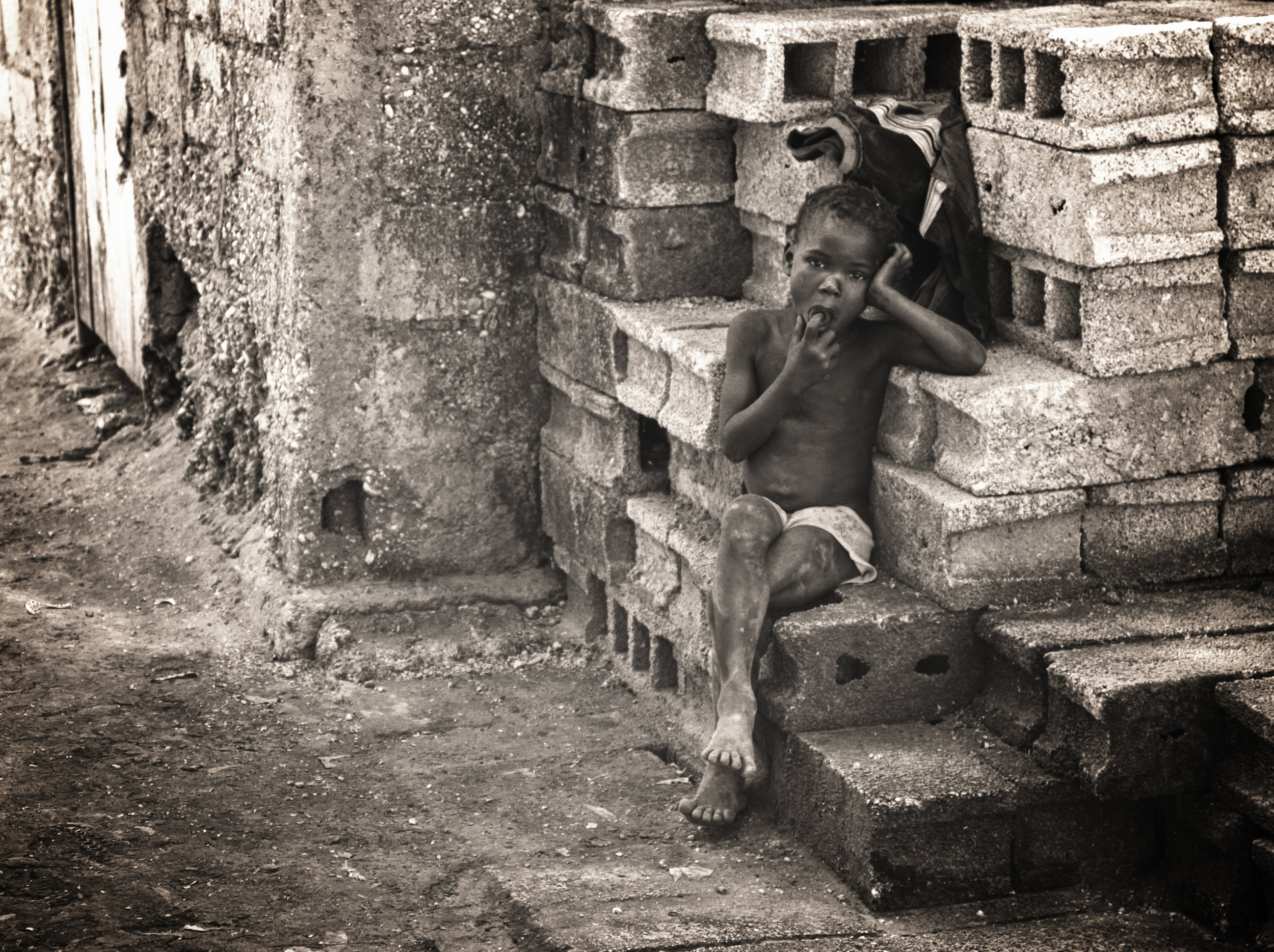 kid on bricks.JPG