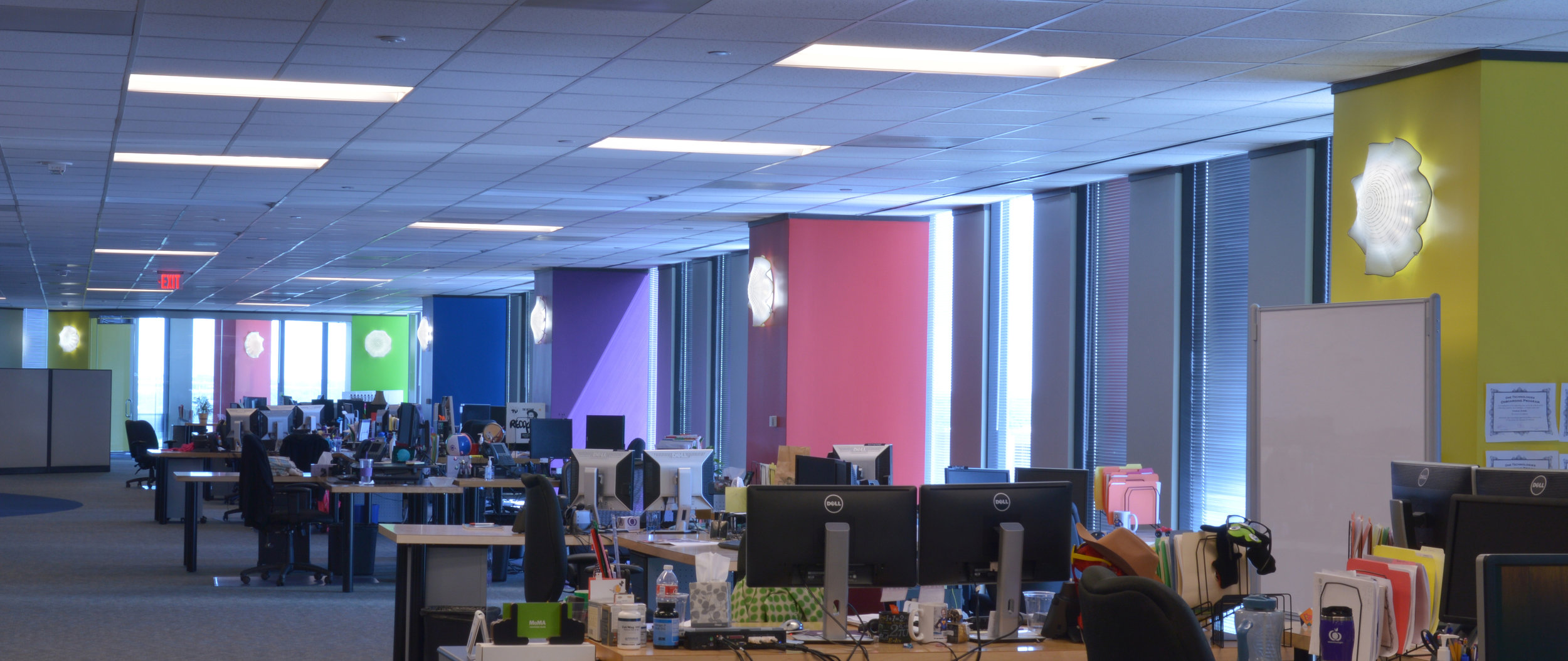 Art glass lighting used to create excitement in an open plan office space. See our  Lighting Options
