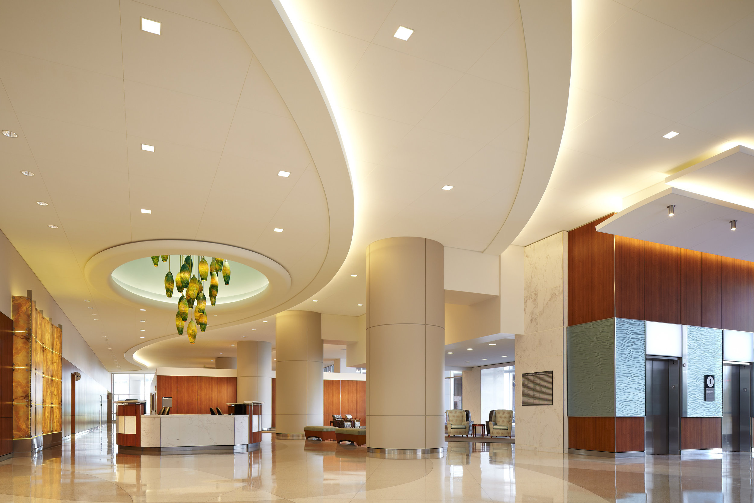 """The """"Jewel""""  art glass lighting piece guides visitors to the front desk at Texas Children's Hospital"""