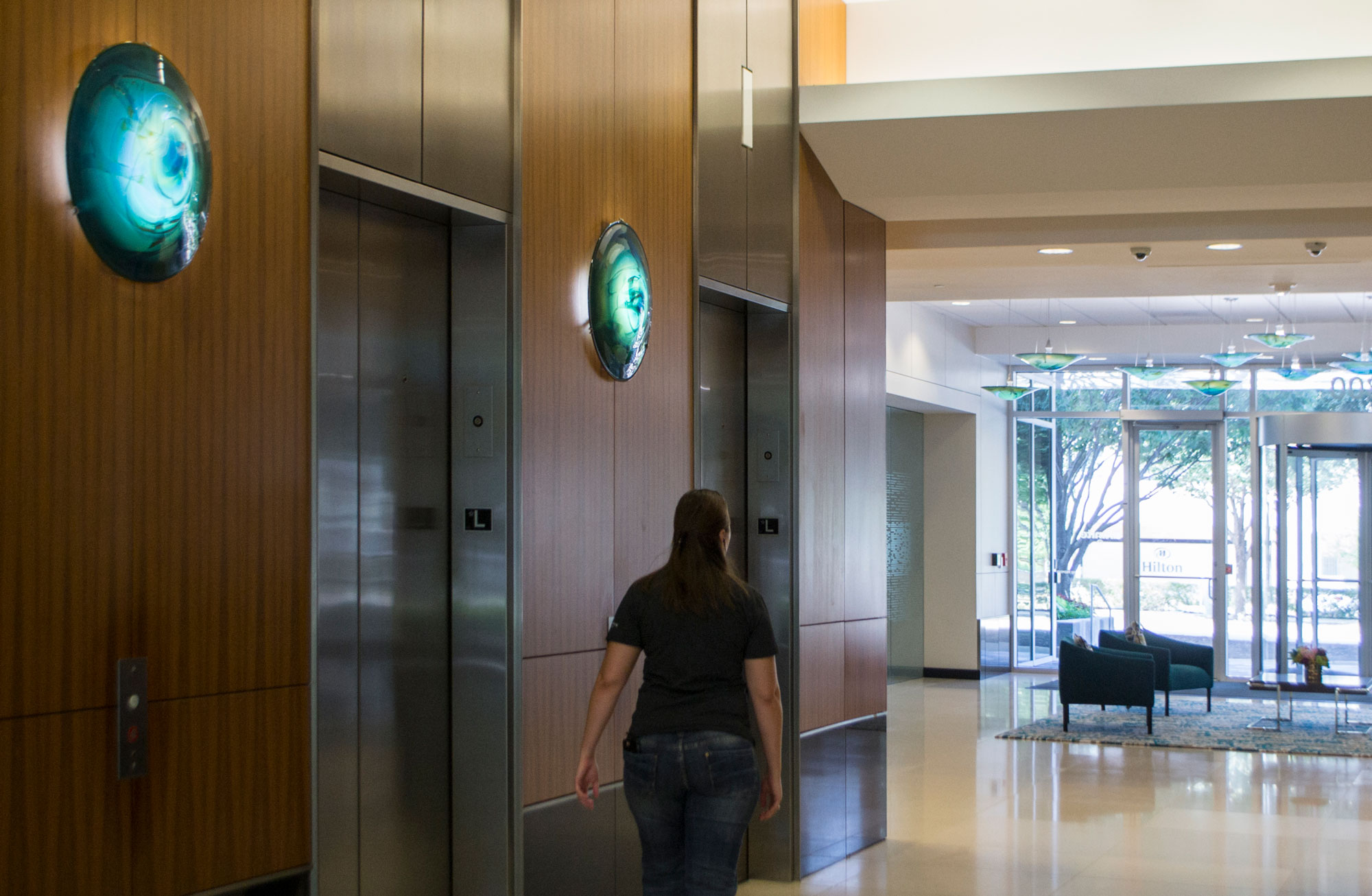 """Elevator sconces carry the color scheme through into to the main lobby in  """"Emerald Canopy"""""""