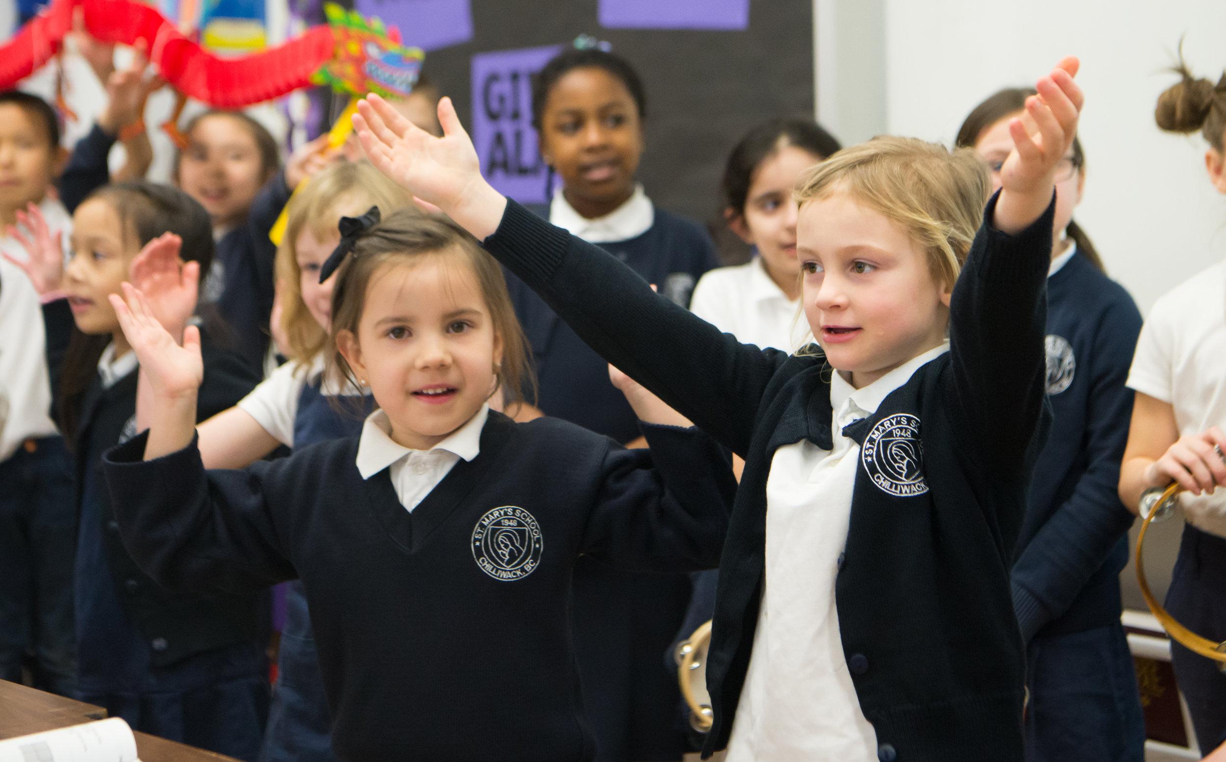 Children wearing the Saint Mary's School uniform.