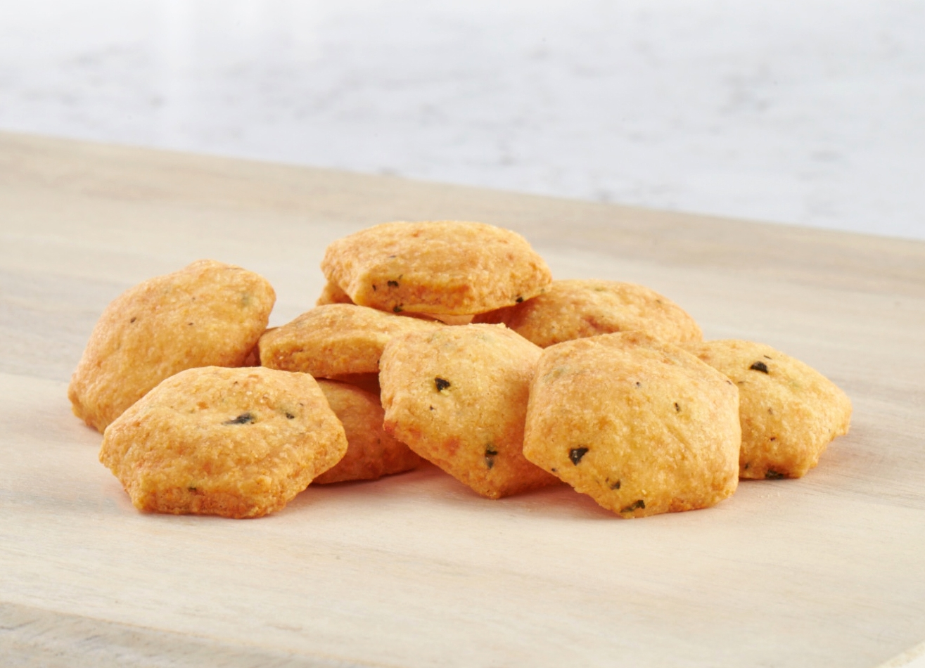 CHEDDAR CRACKERS   A delicate, savory cracker baked with premium herbs, spices, and cheddar cheese that's deliciously unbelievable!  View Ingredients