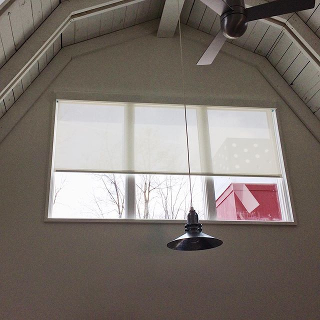 Check out this solar shade by Draper that we designed and installed at a renovated barn turned vacation home in Sawyer, Michigan. We did this project in conjunction with cool Chicago architecture firm Von Weise & Associates. Swipe to see how well, in the context of the room, the shade is masked — it becomes next to invisible. 2nd pic via @vonweiseassociates . . . . . #windowtreatments #solarshade #draper #design #designer #architecture #window #white #barn #chicago #michigan #sawyer #tech #solar #shade #designwindowsolutions #makeyourviewashadebetter