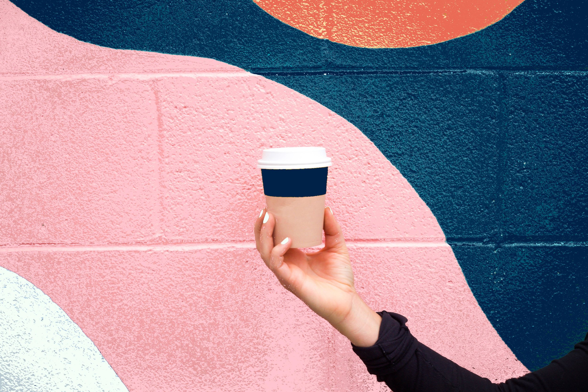 A photo of a coffee cup in a woman's hand