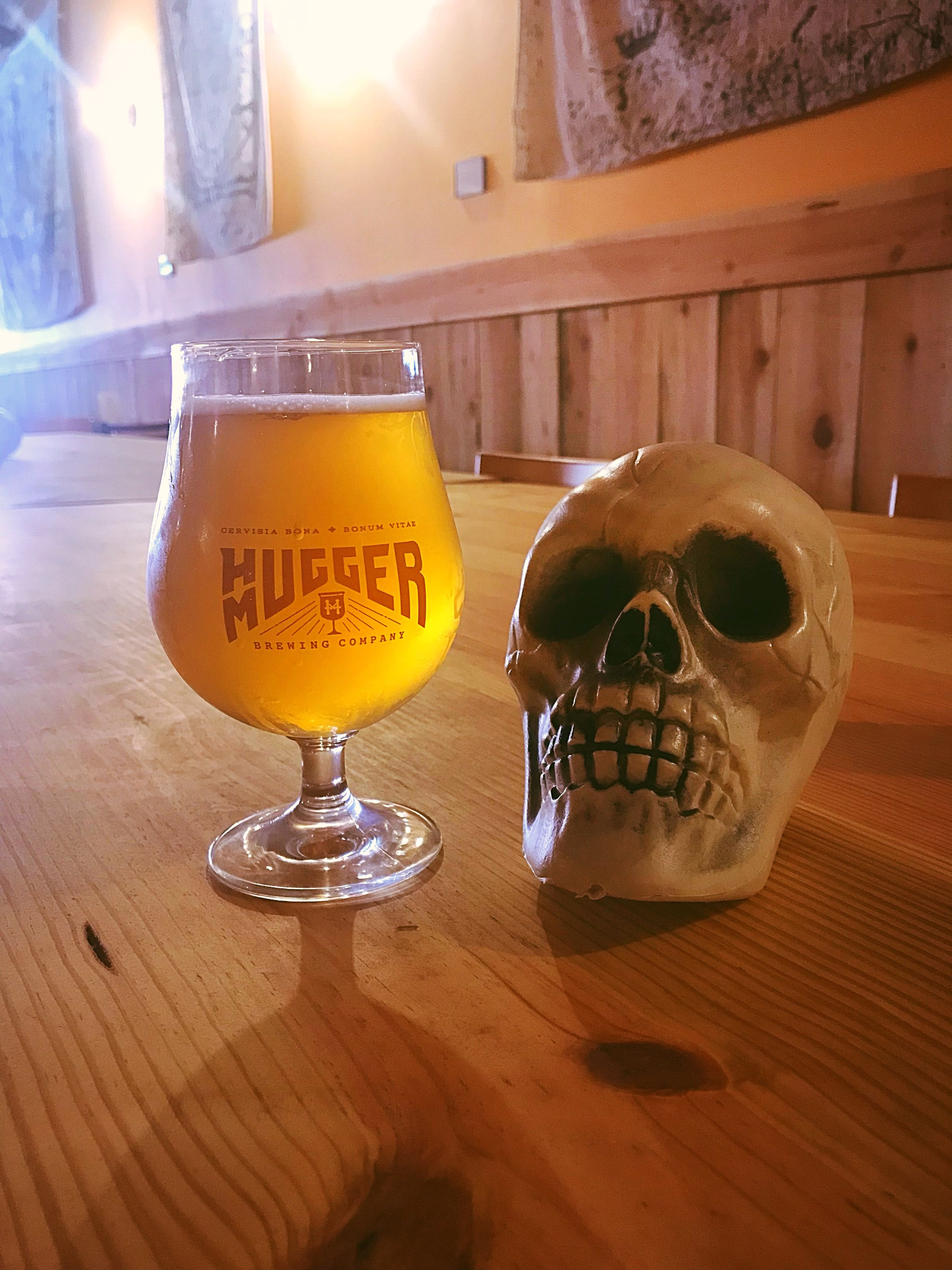 """- Hastur """"The King in Yellow"""" Belgian Tripel 9% ABV 20 IBUNamed after the half brother of the fabled Cthulu, Hastur influences the creative mind from afar. This 9% peppery and spiced Belgian Tripel will deceive in strength. Pale yellow in color and dry on the palate this quaff demon will sneak up on you."""