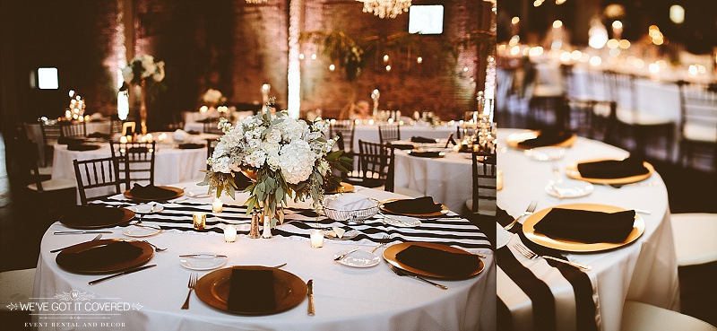 Wedding reception table decorations include gold chargers, black and white striped table runner, gold candles for an accent and beautiful flower arrangements as the focal point.