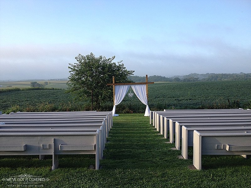 Crisp morning wedding with an outdoor ceremony that has draping on the arch and a chandelier.
