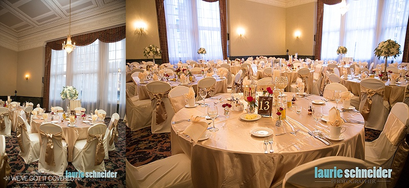 Table numbers and centerpieces on gold satin linens