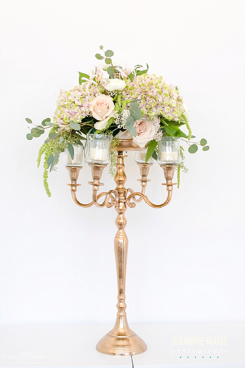 Gold candleabra used with floral plate and candles
