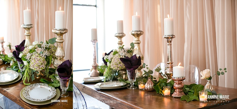 Wood table set with gold plates, eggplant napkins, gold and blush candlesticks, and garland mixed