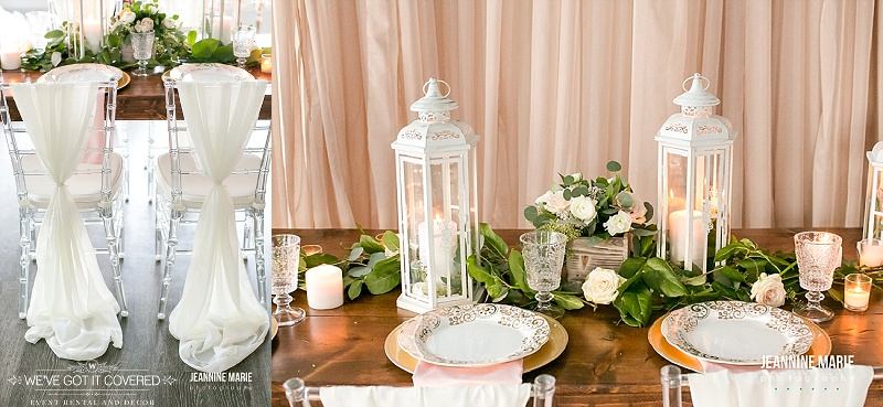 Wood table with white lanterns, roses, wood boxes filled with flowers, candles and gold chargers