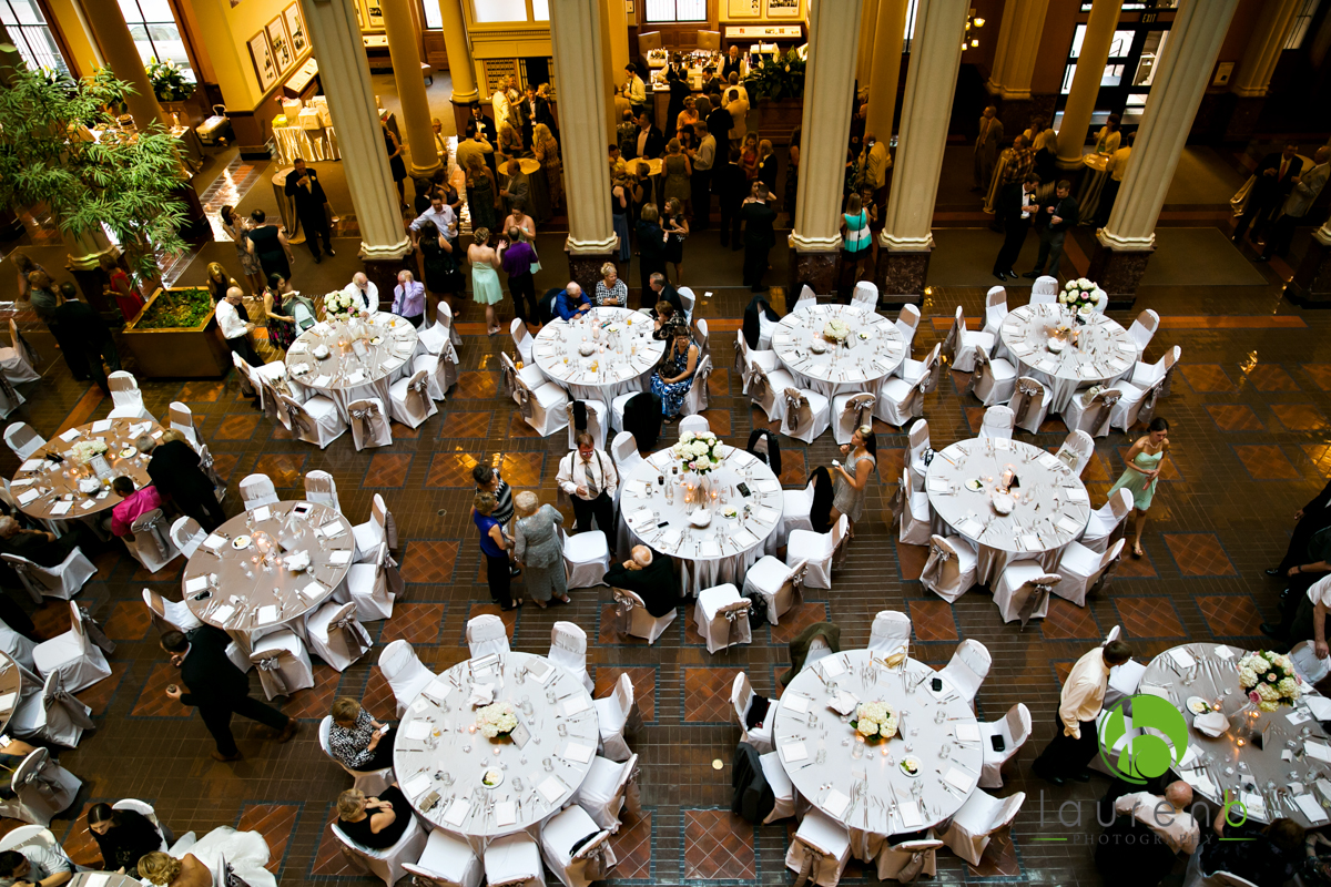 top view of silver colored table linens and white chair covers at a St. Paul wedding venue