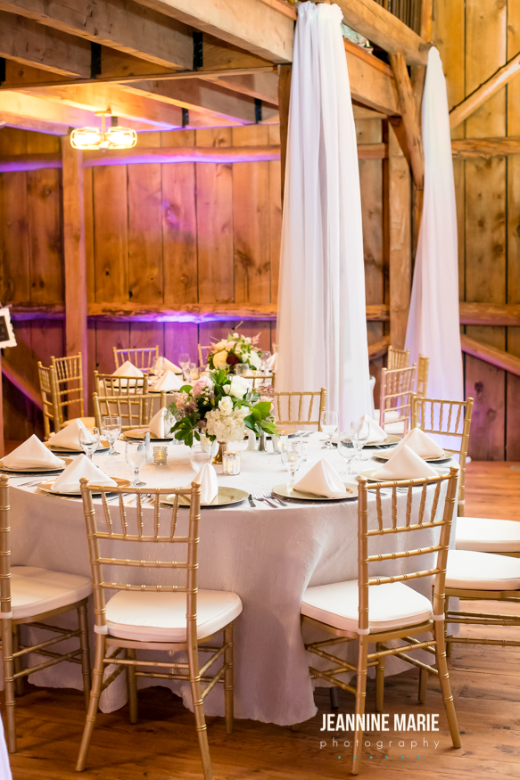 Wedding barn draping with silver linens and gold accents