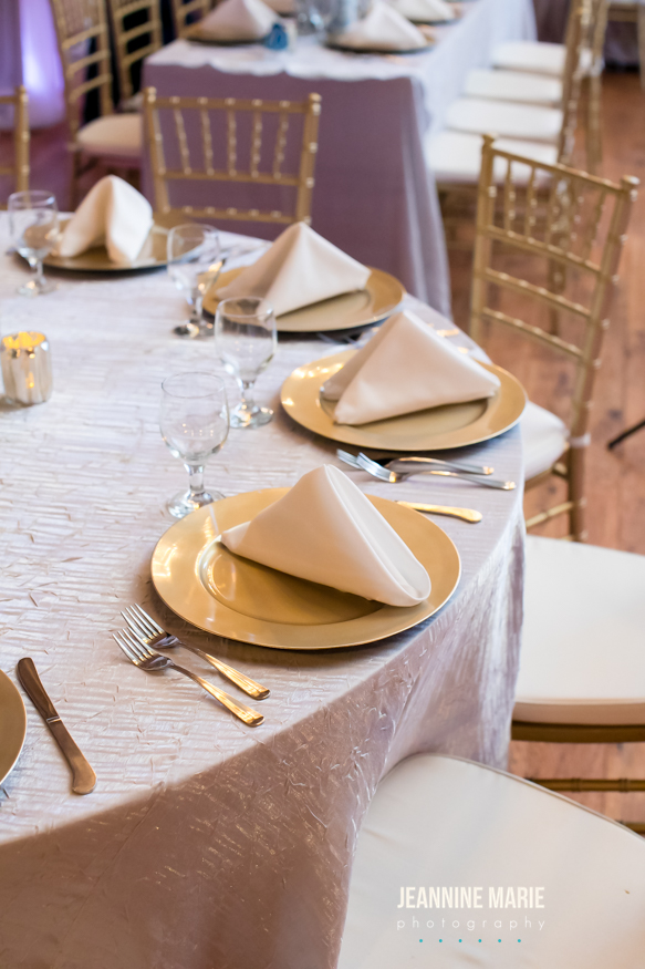 Shiny silver table linens with texture and gold accented chargers