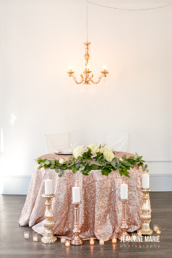 Sweetheart table with a blush sequin linen. The added candlestick and chandelier decor add sweet romance