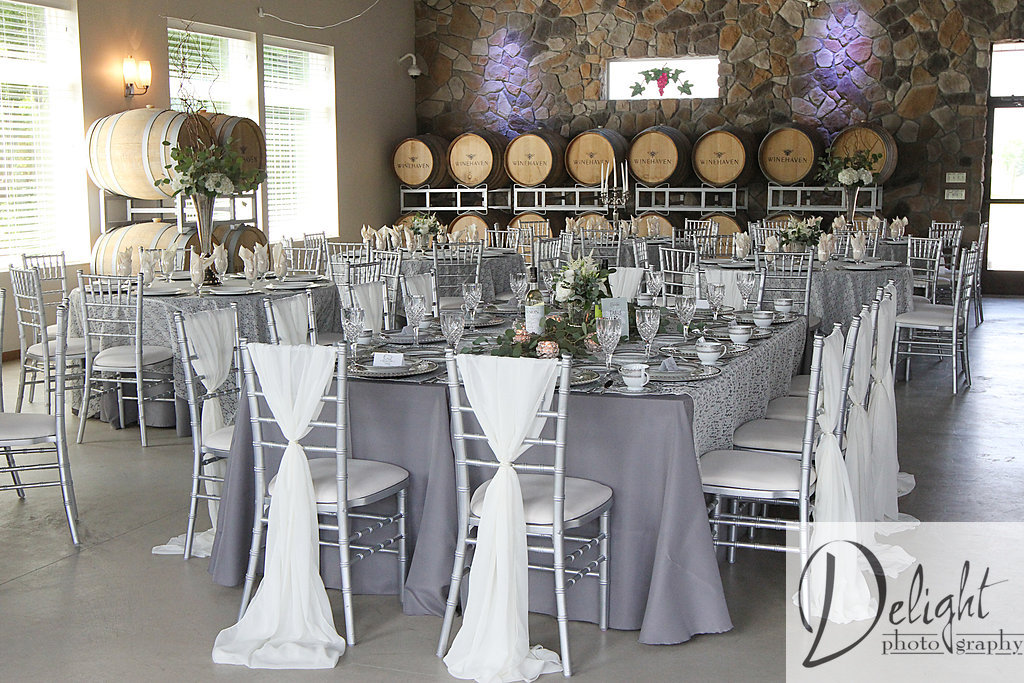 guest tables with a cool and sophisticated decor. Chiffon chair backs and grey linens with lace overlays
