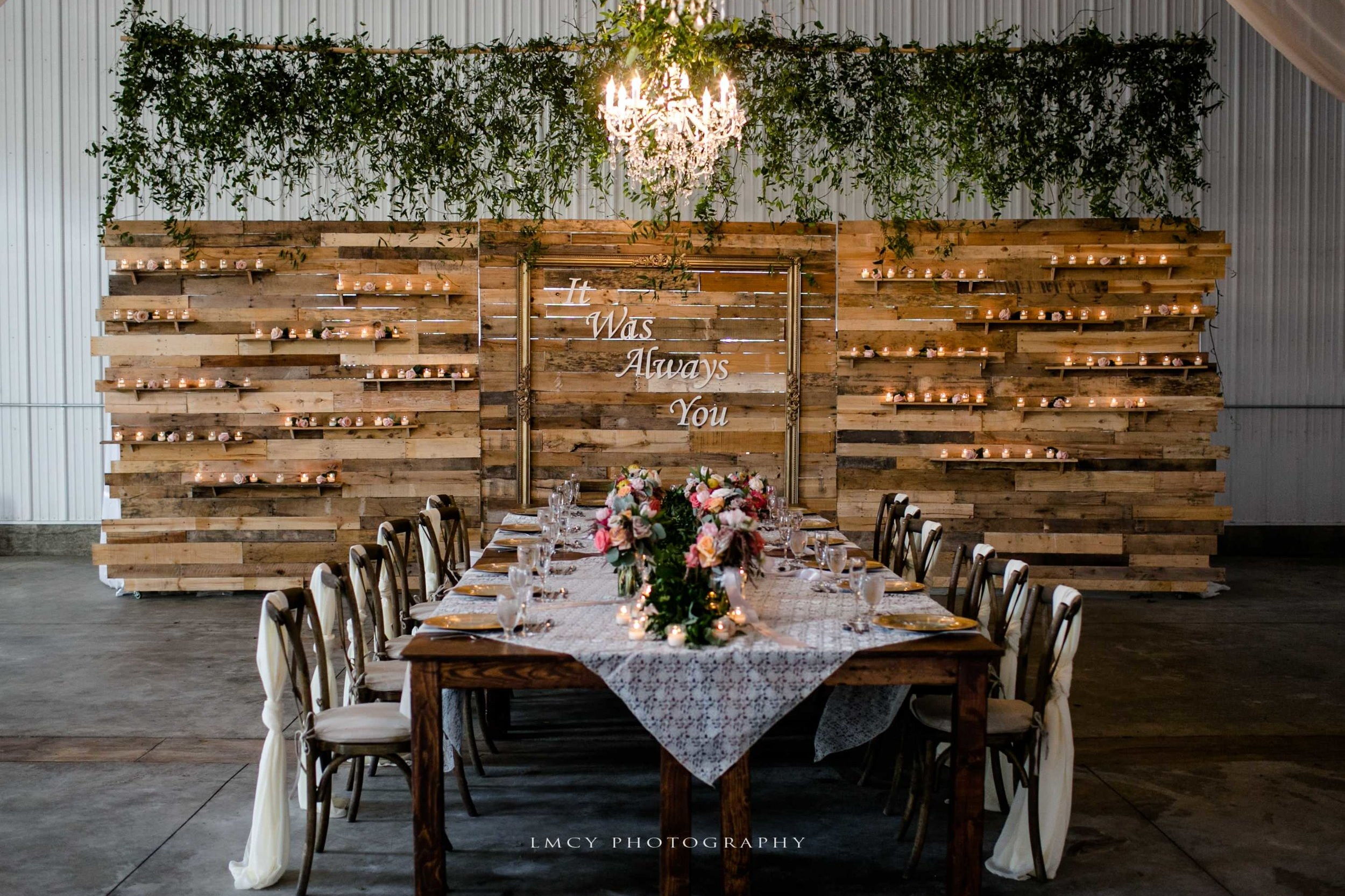 wedding head table backdrop with farmstyle tables and decor