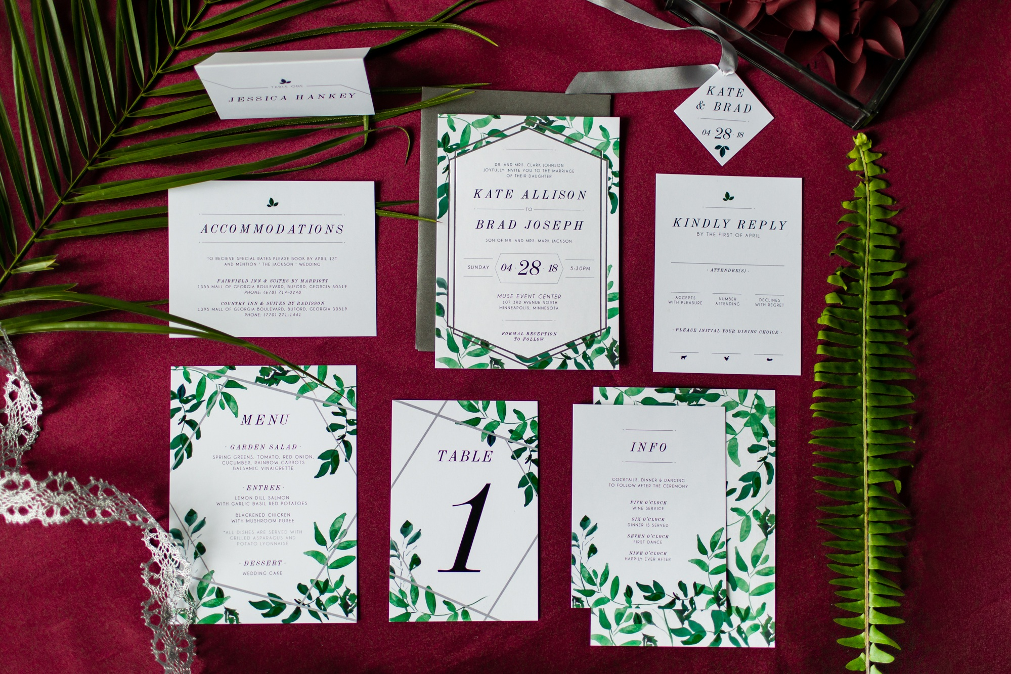 Fern inspired stationary displayed on burgundy table linen