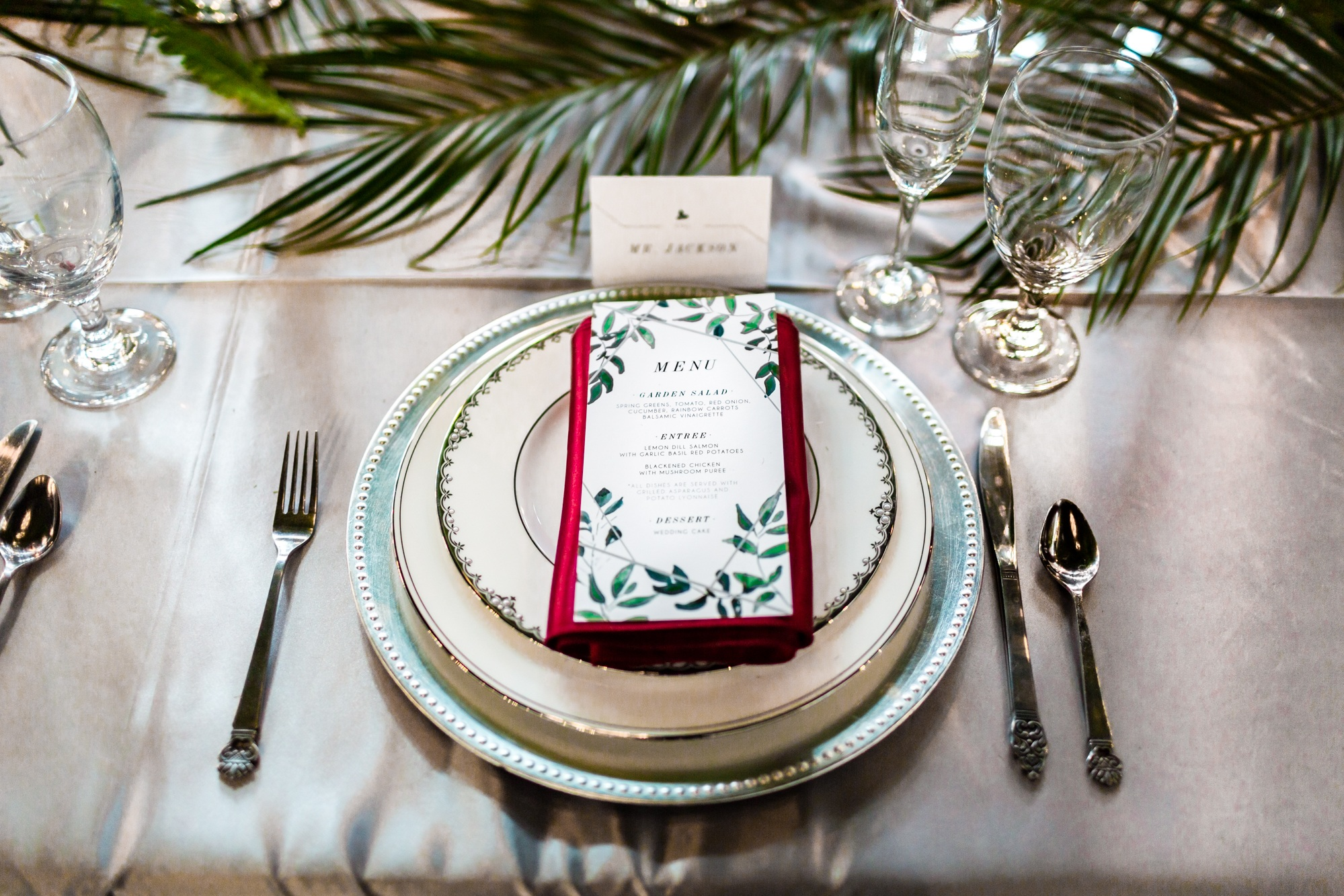 guest plate showing menu and burgundy napkin