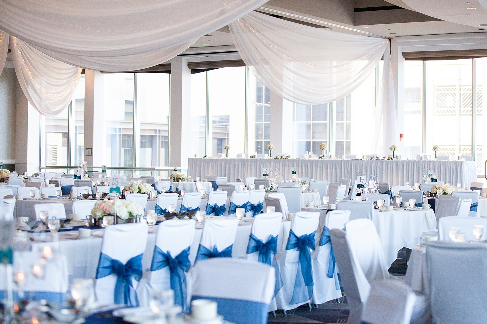 Simple all white wedding with a splash of blue color