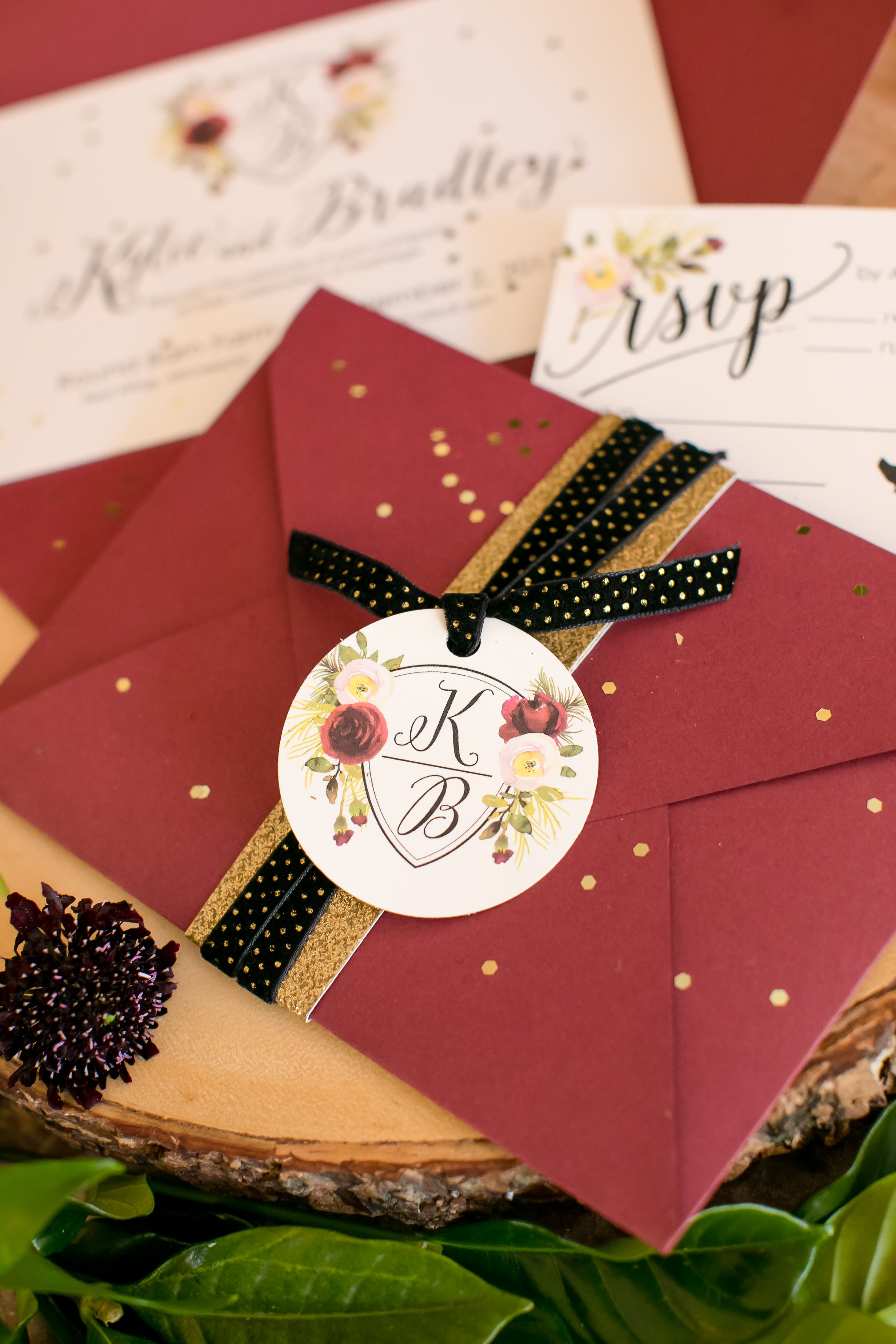 Burgundy envelope with gold accents for simple stationary that everyone will love