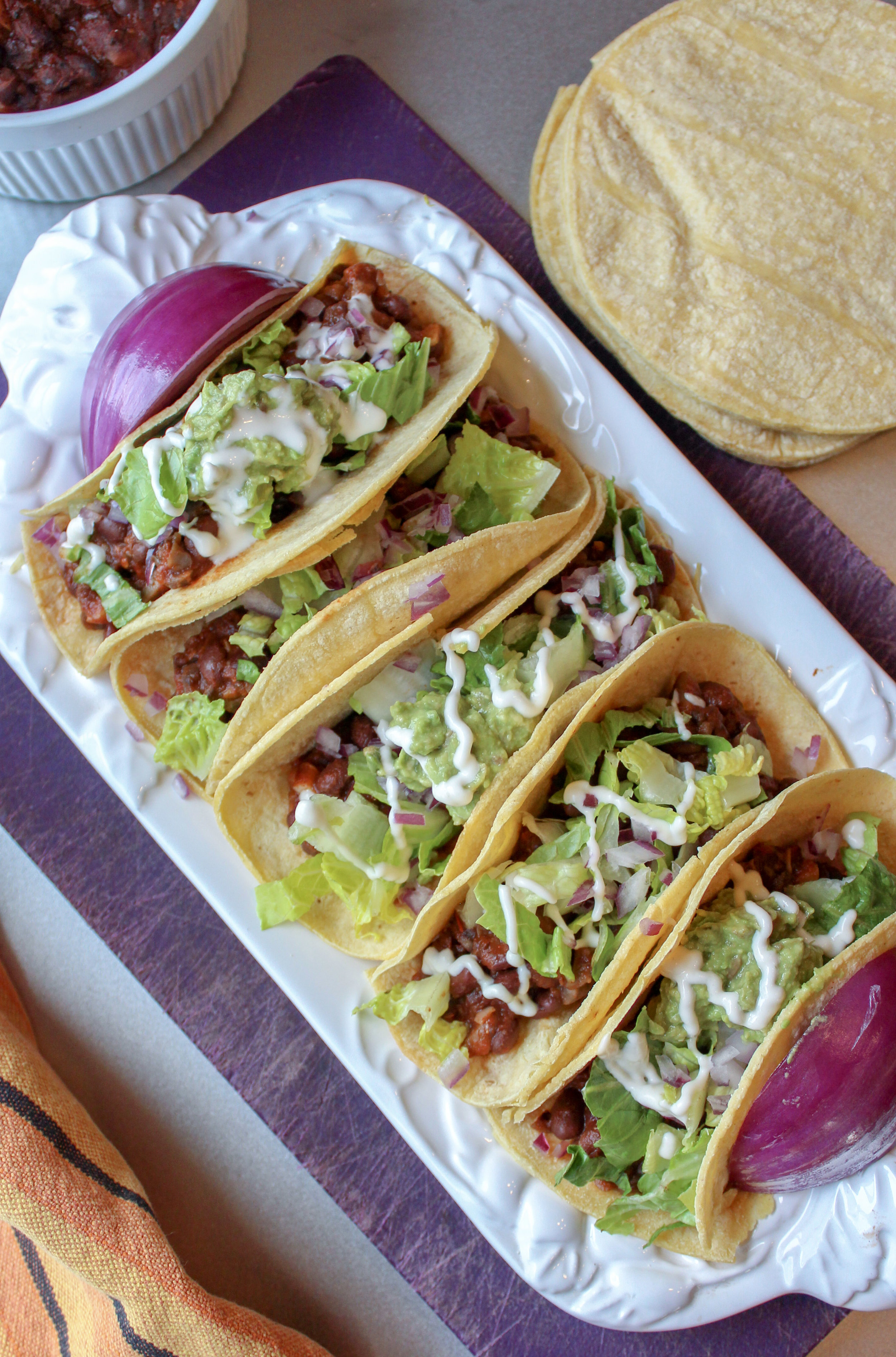 Meaty, chewy and delicious vegan mushroom and black bean tacos. Sure to satisfy even the pickiest carnivore. Gluten free, dairy free and meat free. Pressure cooker and stove top directions available. #vegan #taco #healthy #easy #pressurecooker #instantpot www.musicandmunchiesblog.com